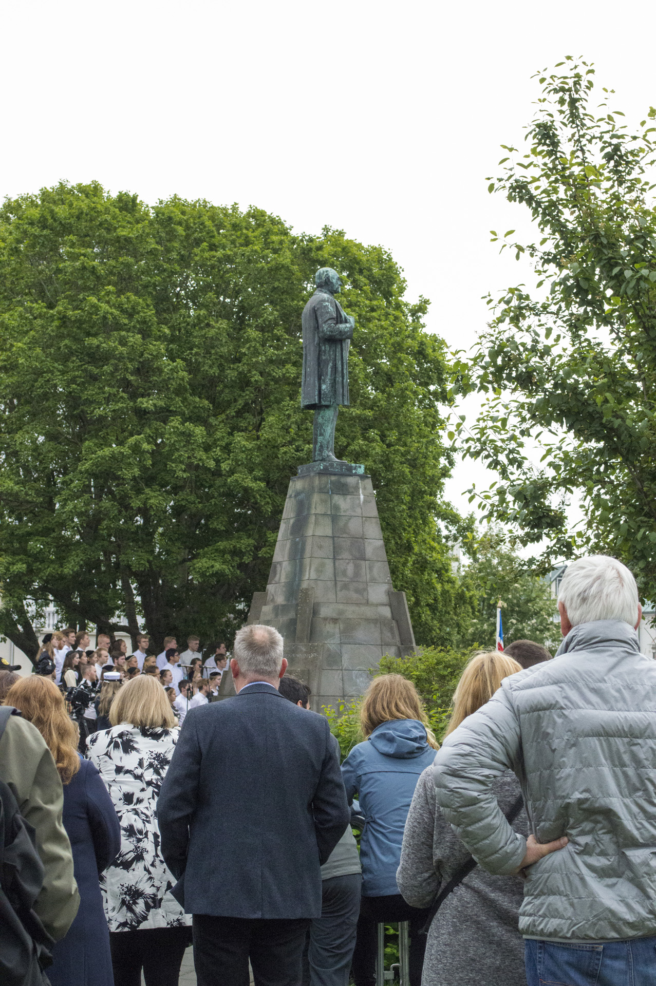 People gather to celebrate National Day in Austurvöllur, Reykjavík, Iceland. Above the crowd is a statue of Jón Sigurðsson, leader of Iceland´s independence movement.