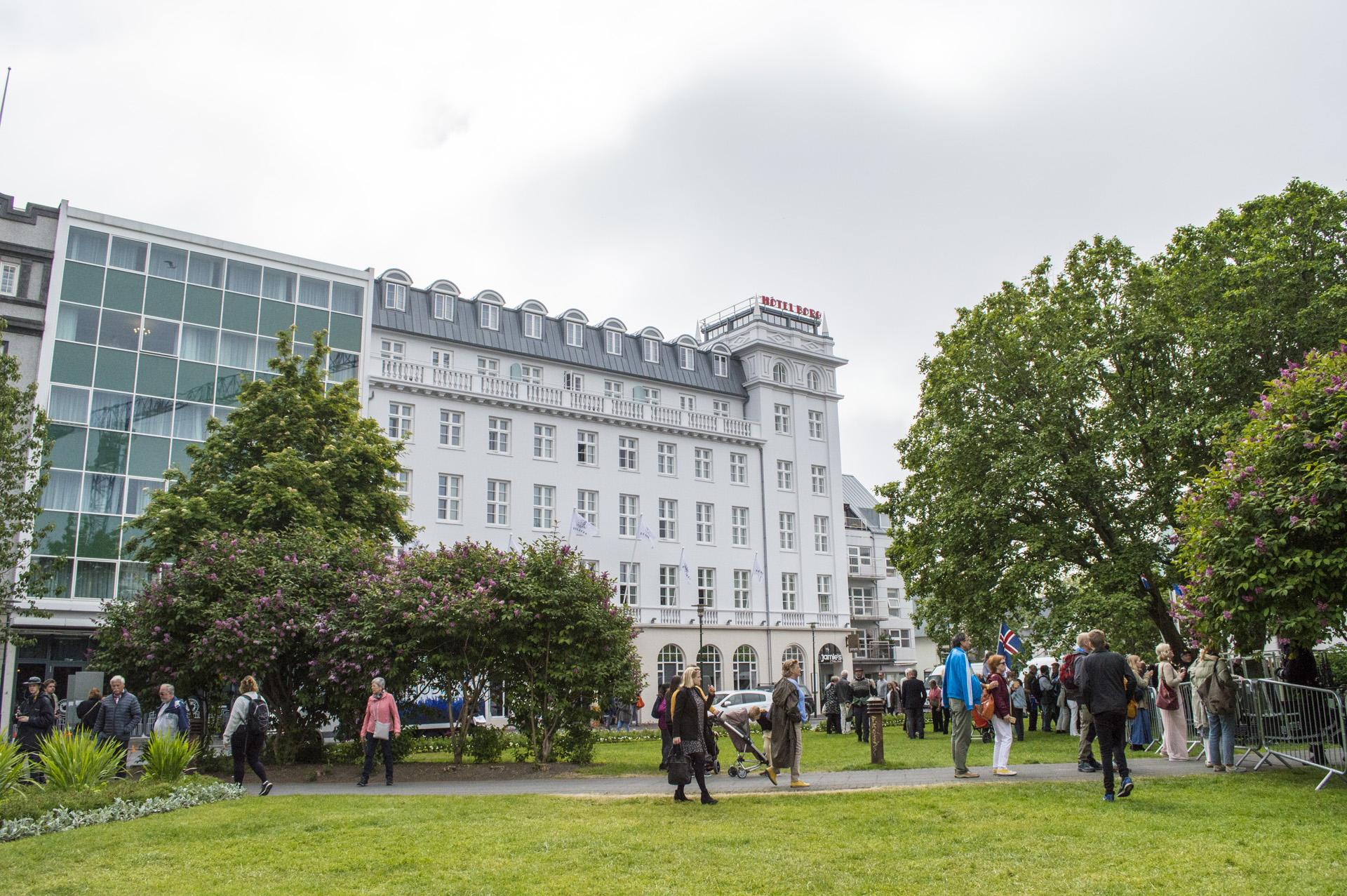 The National Day crowd walks around Austurvöllur, Reykjavík, Iceland.