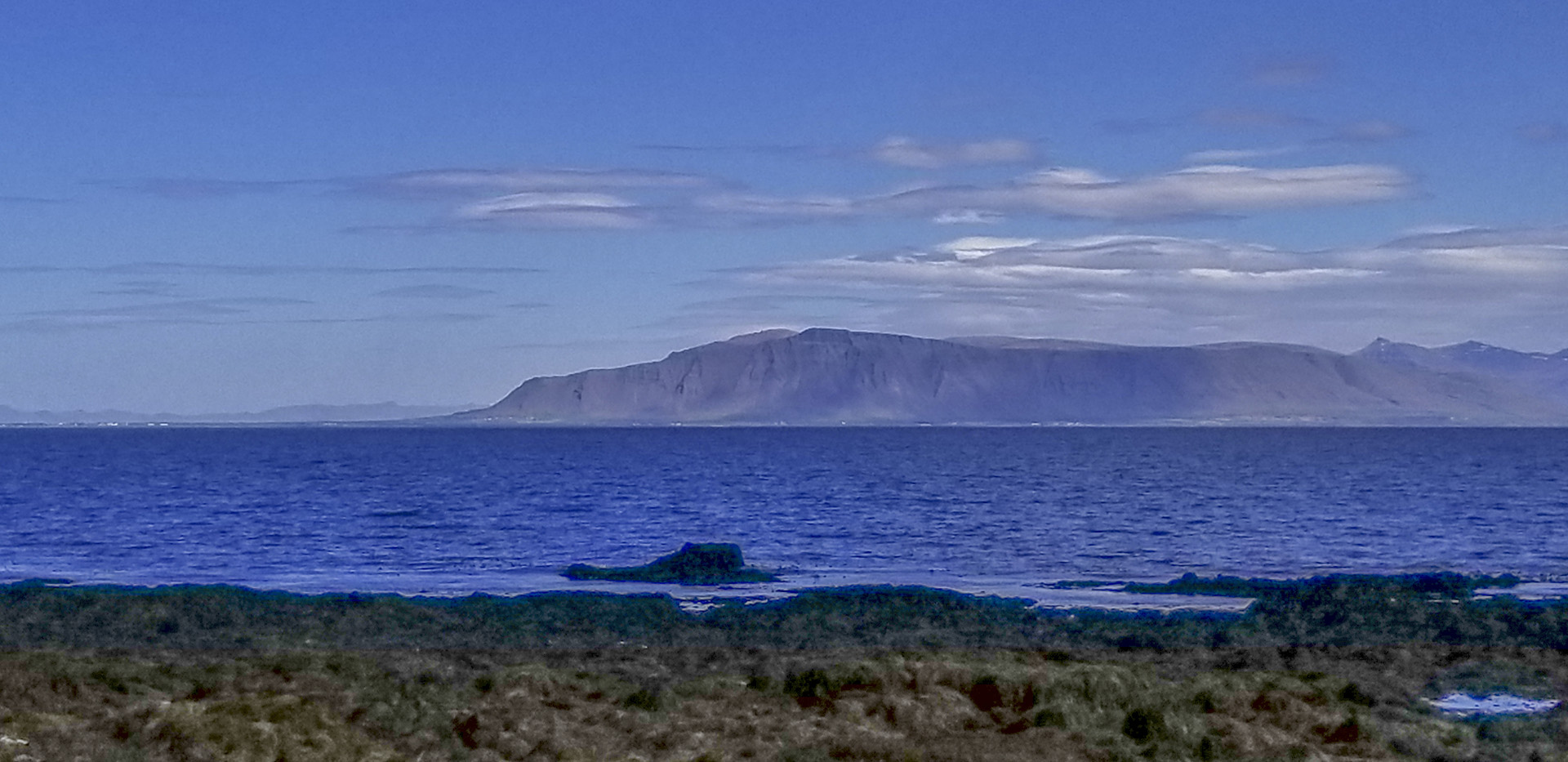 Looking out at Faxaflói bay, toward Akrafjall. Picture taken from the western end of the Sculpture and Shore Walk in Reykjavík, Iceland,