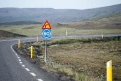 Roadsigns before a curve along Skeiða-og Hrunamannavegur, north of Flúðir, Iceland.