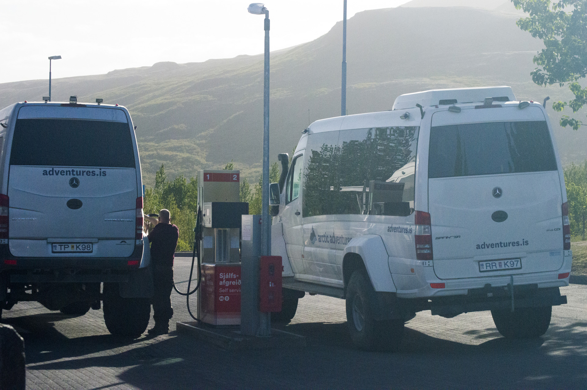 Off-road tourist vehicles refill at the Geysir Center.