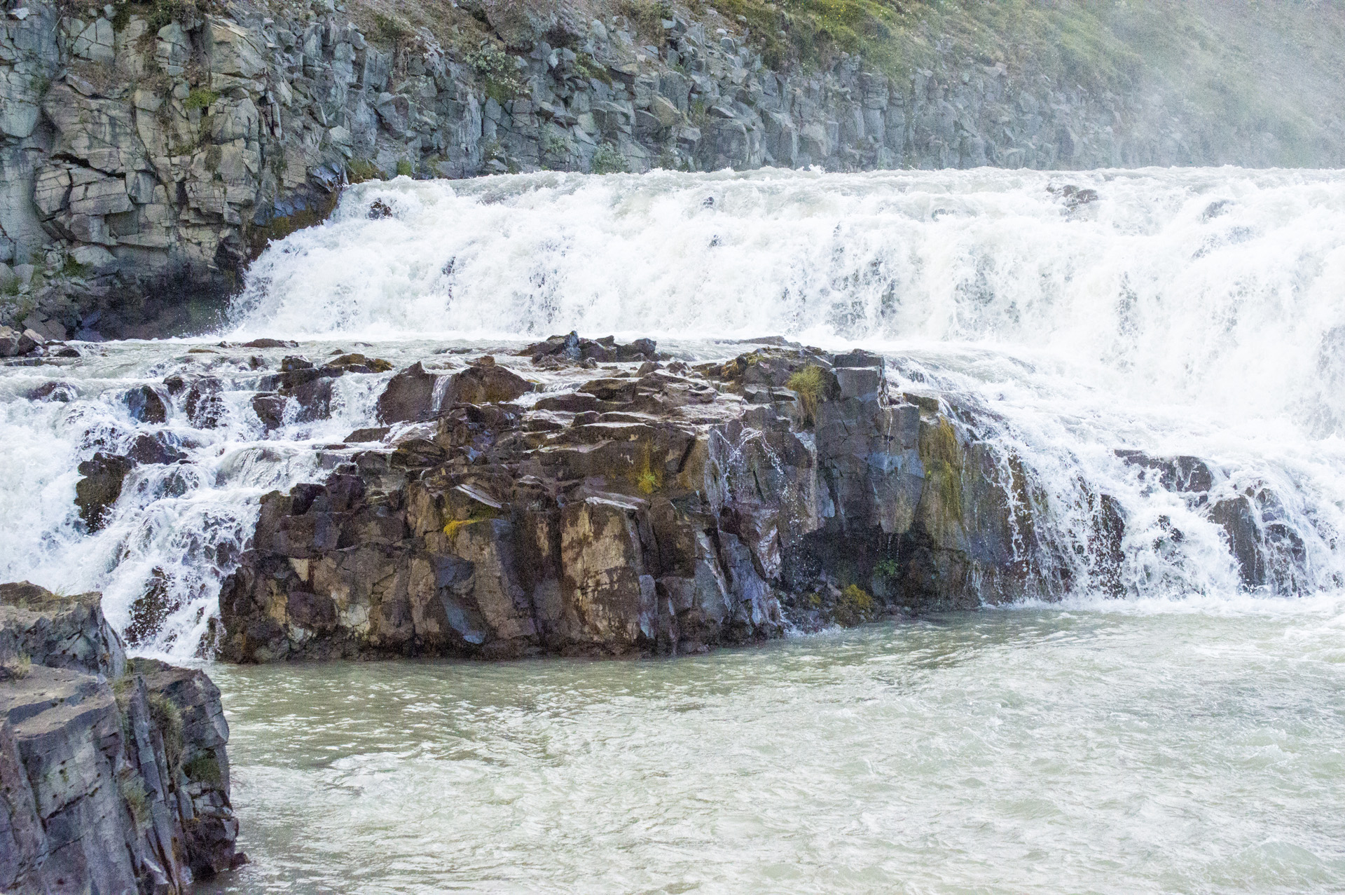 Rock formation rise out of the Hvitá river, near upper part of the  Gullfoss waterfall, Suðurland region, Iceland