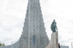 A statue of Leif Eríksson stands in front of Hallgrímskirkja, Reykjavík, Iceland. The church is the second-tallest building in Iceland.