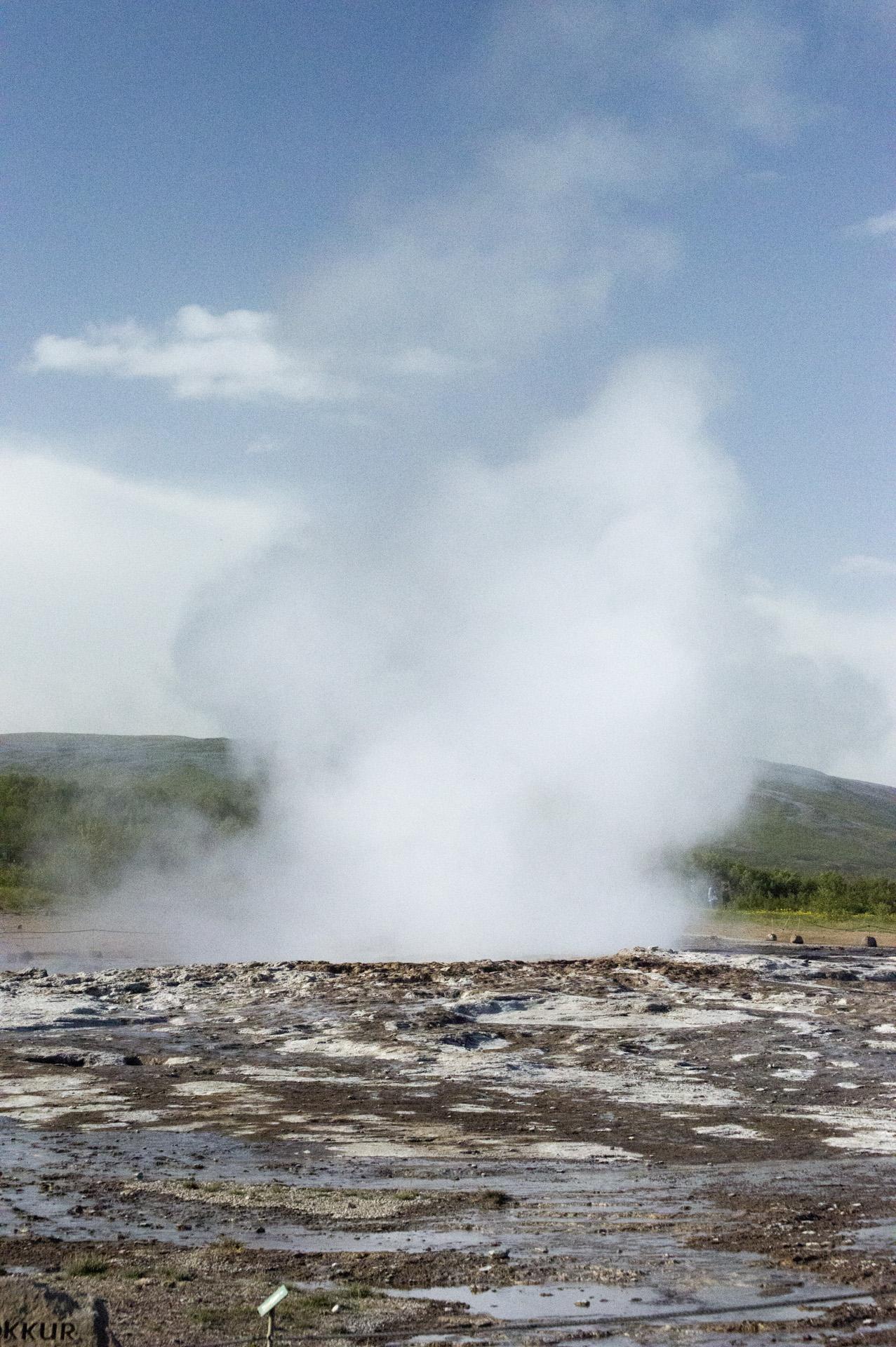 Strokkur erupts in the Geysir Hot Spring Area, Haukadalur Valley, Iceland.