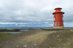 Lighthouse overlooks Breiðafjördur from Súgandisey Island, Stykkishólmur, Vesturland region, Iceland.