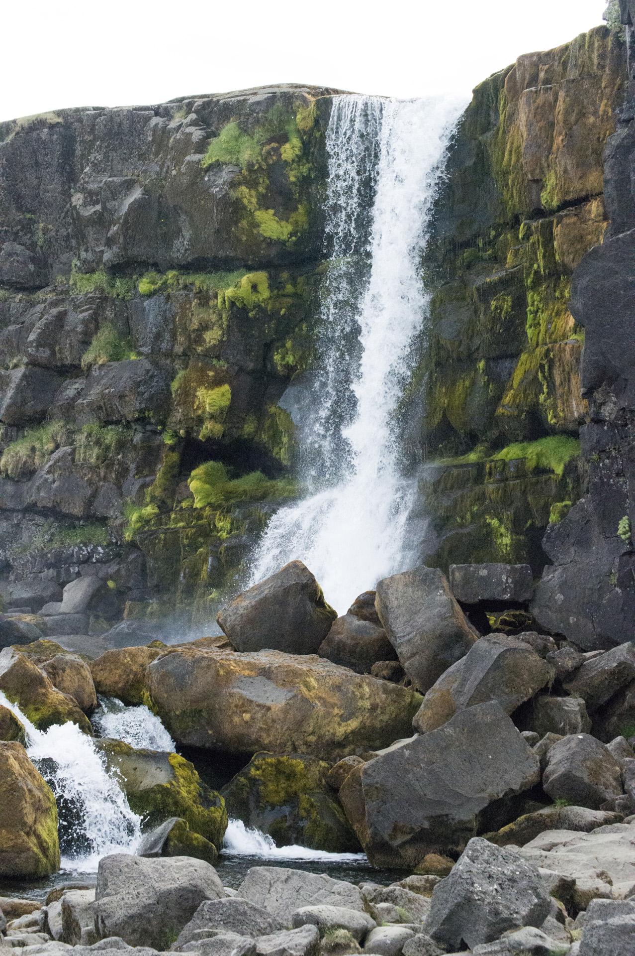 Öxarárfoss waterfall flows into the Mid-Atlantic Ridge rift valley at Þingvellir National Park, Suðurland region, Iceland.