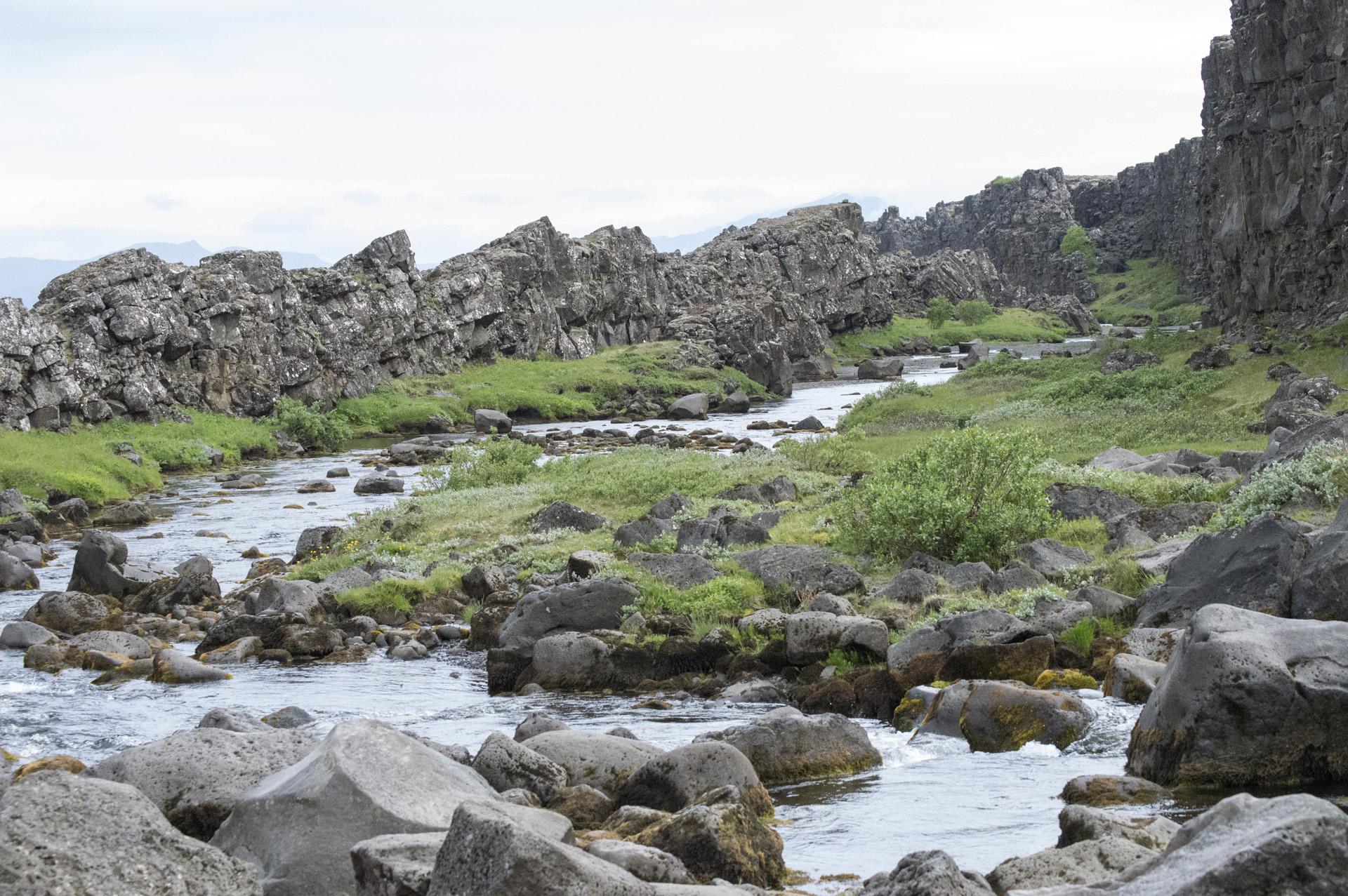 Öxará river flows away from Öxarárfoss in the Mid-Atlantic Ridge rift valley at Þingvellir National Park, Suðurland region, Iceland.