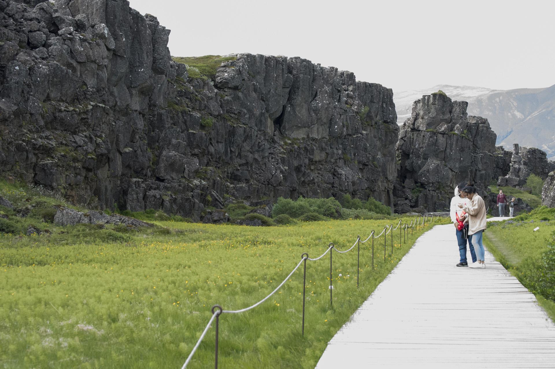 Walking along the rift valley in the Mid-Atlantic Ridge, Þingvellir National Park, Suðurland region, Iceland.