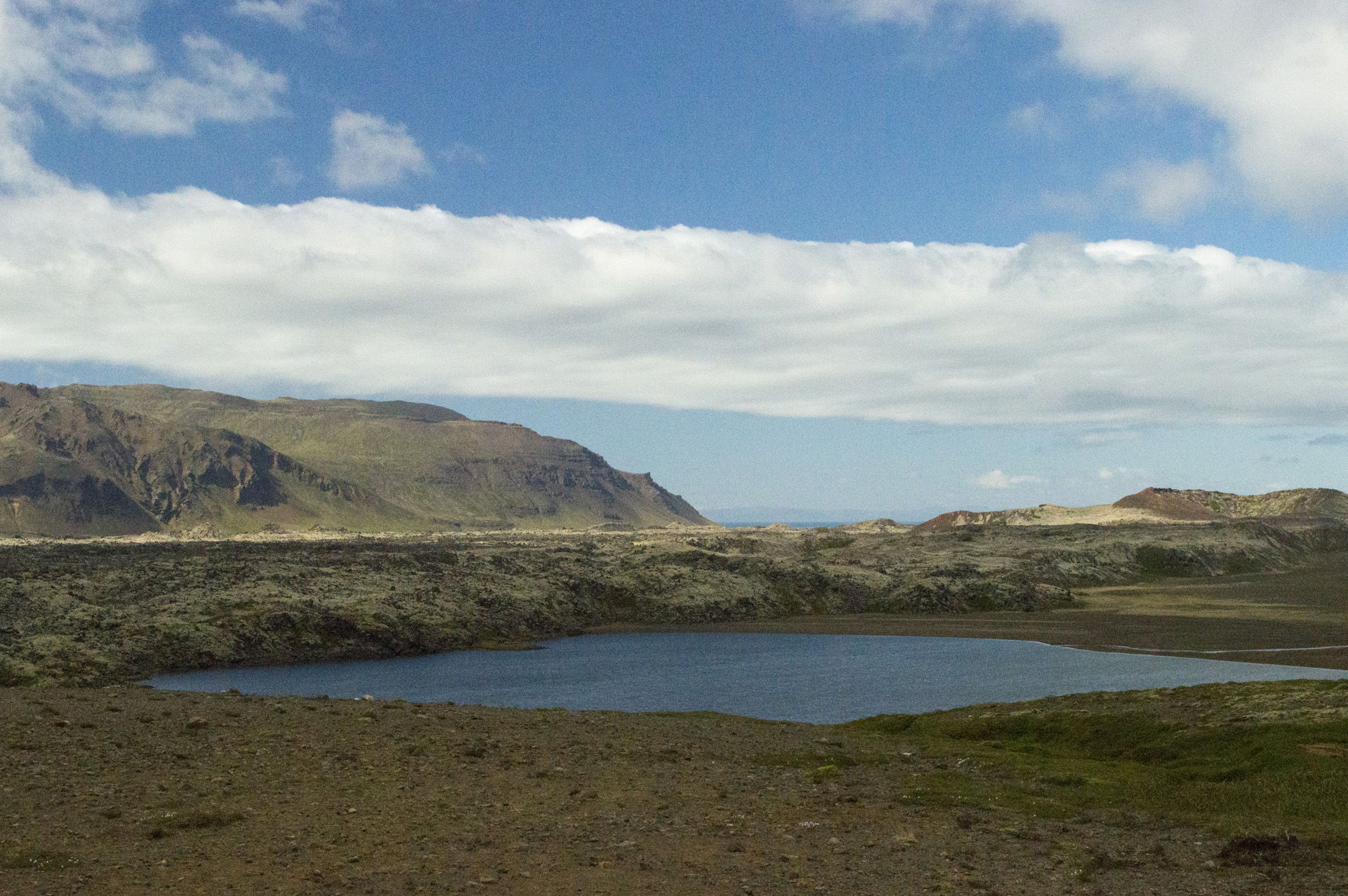 Selvallavatn lake in front of some of the mountains on the north side of the Snæfellsnes peninsula, Vesturland region, Iceland.
