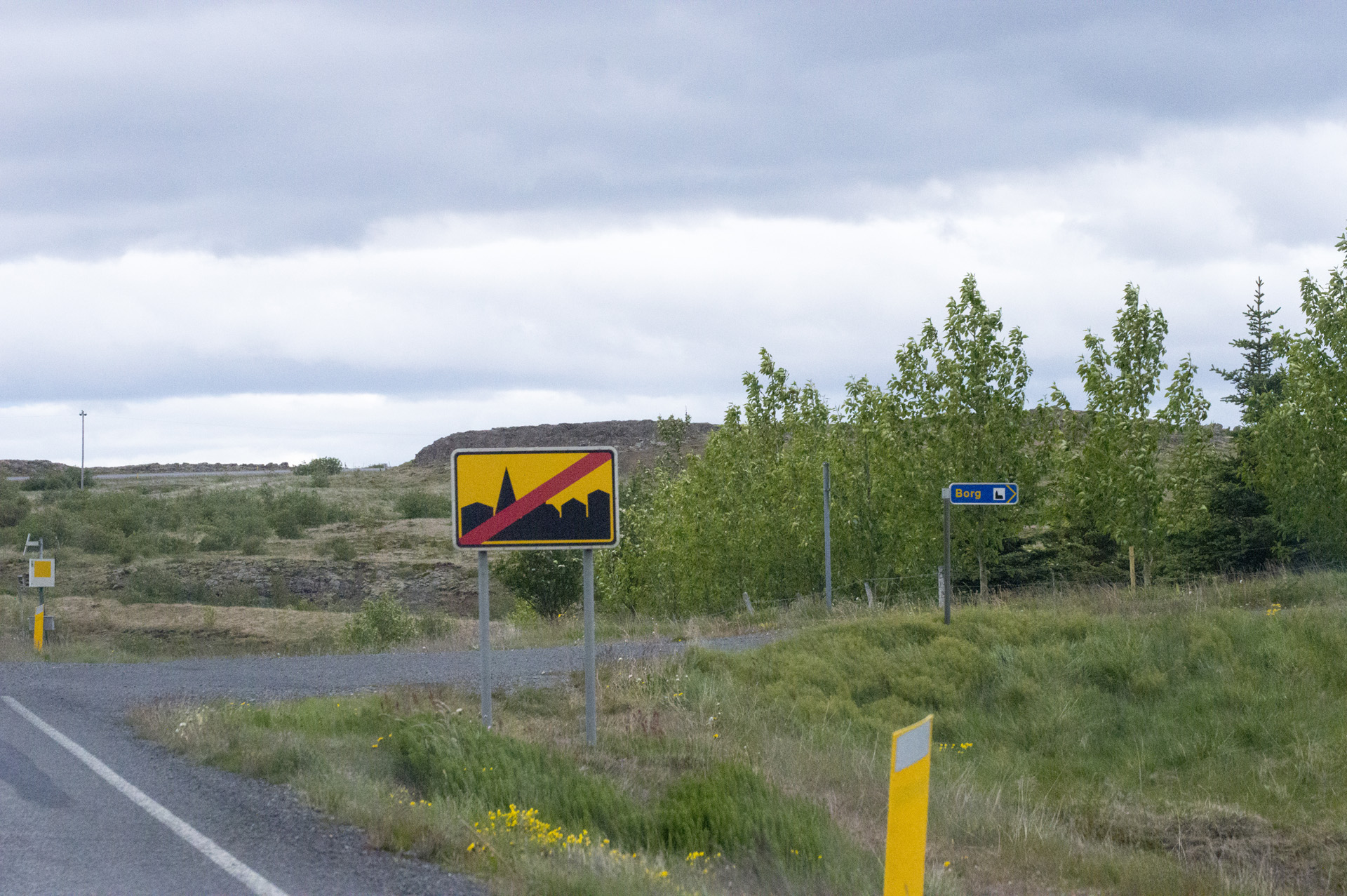 Example of a sign indicating the end of city limits. This sign is northbound on Snæfellsnesvegur, leaving Borgarnes, Vesturland region, Iceland.