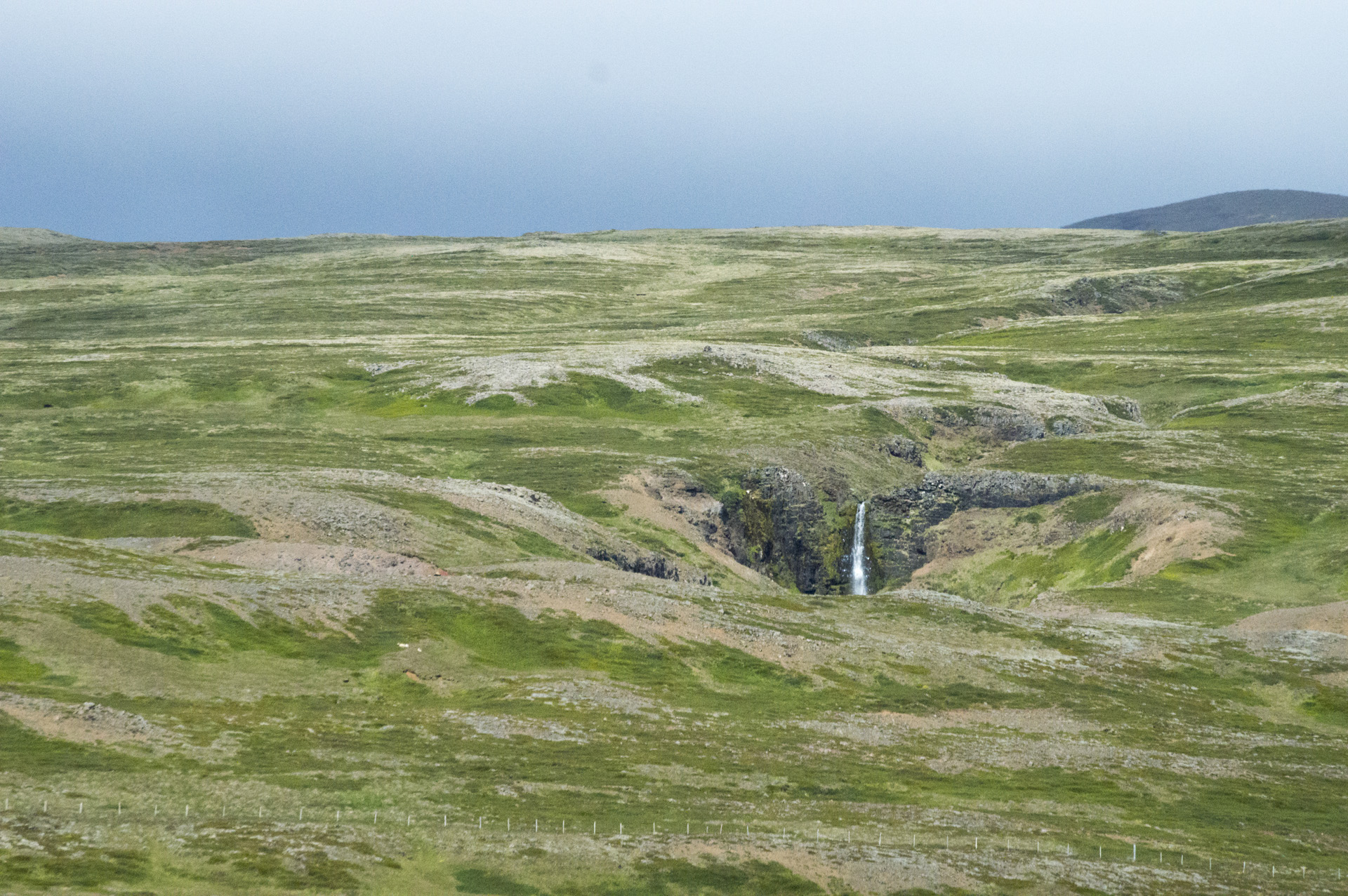 Small waterfall west of the Gerðuberg Cliffs, Vesturland region, Iceland.